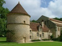 The dovecote and church at Fontenay Abbey.