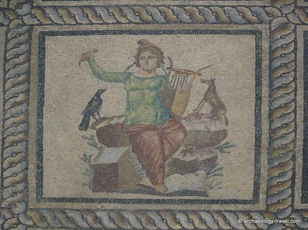 A close up of Orpheus, shown with his lyre