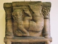 A carved Romanesque capital depicting a mermaid.