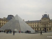 Three glass pyramids now mark the entrance to the Louvre Museum.