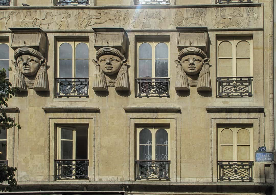 Heads of Hathor on a building named the 'Foire du Caire'.