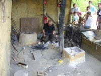 An artisan demonstrating the craft of iron work at Samara