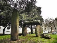 The dolmen and adjacent menhir on the public square.