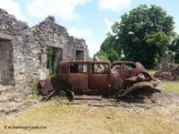 Remains of a few burnt out vehicles.