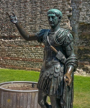A bronze statue of the Roman Emperor Trajan at the start of the London Wall Walk.
