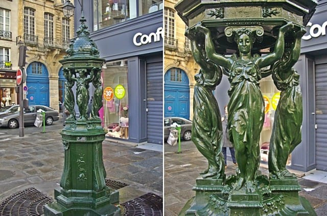 Caryatids in a water fountain on the streets of Paris.