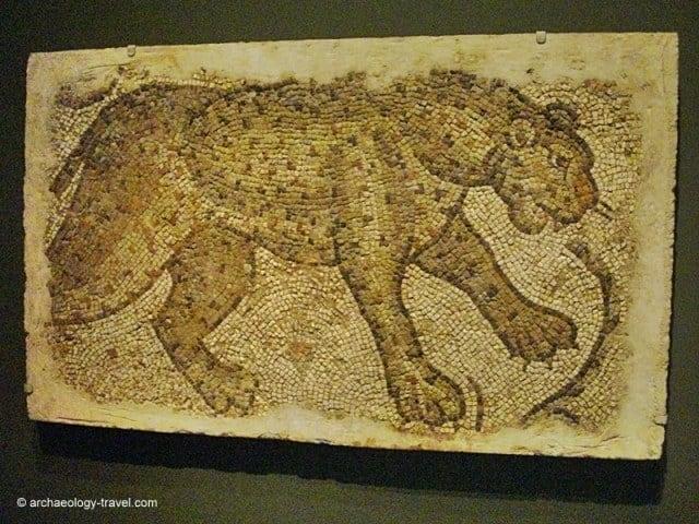 Mosaic fragment depicting a striding leopard.