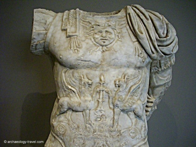 Close up of the upper half of the torso, showing the decorative breast plate.