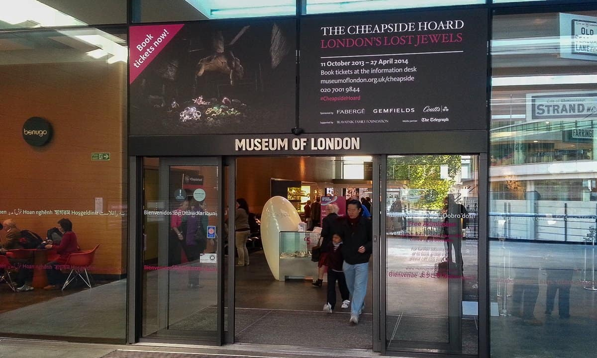 Entrance to the Museum of London showing the exhibition details.