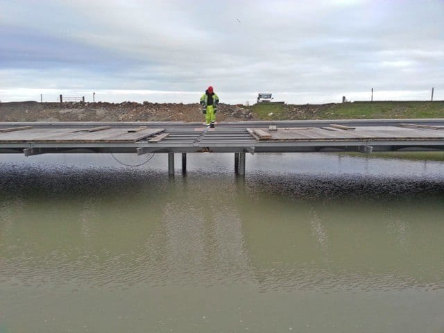 Wooden planks have been added to the metal framework of the new access road.