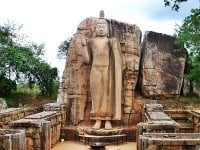 The 12 metre statue amongst the remains of its shrine.