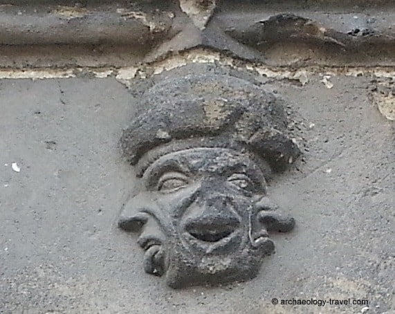 The sculpture on the church of Caudebec-en-Caux with three faces.