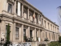 The front neoclassical façade of the National Archaeological Museum of Spain.