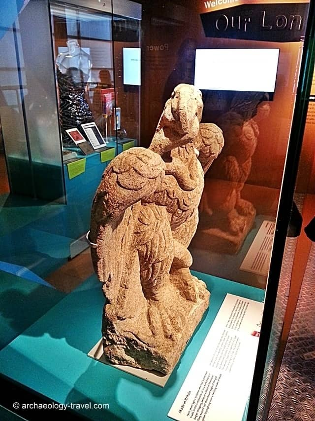 A side view of the sculpture in its display case.