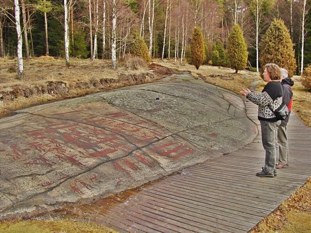 Standing in front of the large panel of bronze age boats.