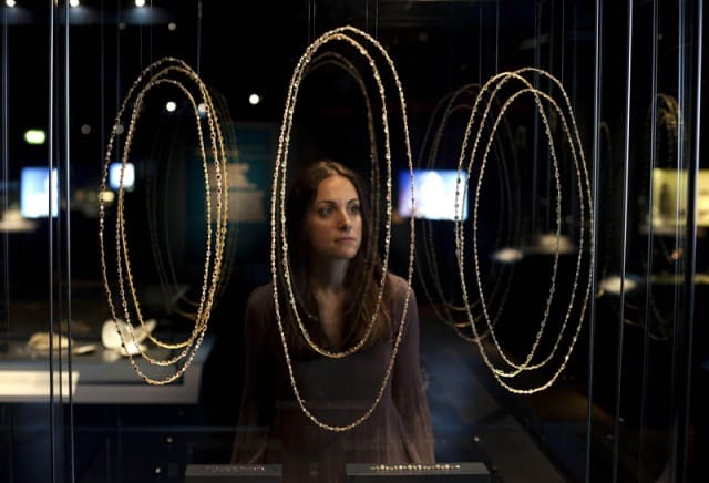 Display of bejewelled necklaces and chains.