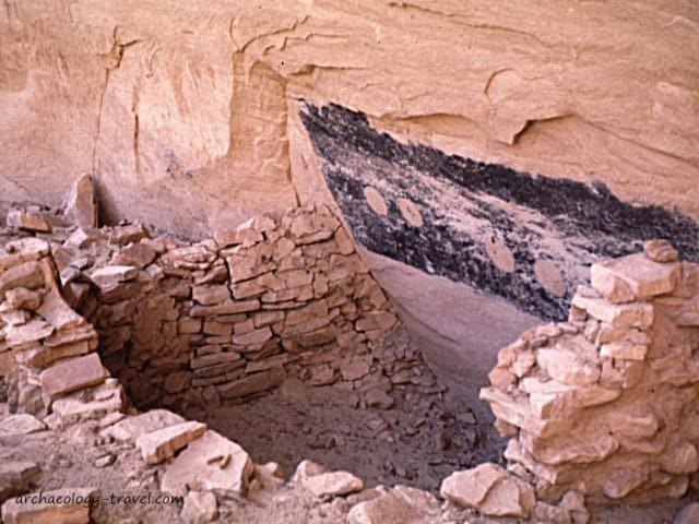 A kiva built up against the wall of a rock shelter.