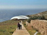 Megalithic Mnajdra Temple on the edge of a rugged coastline in Malta.