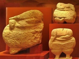 Stone figurines from Hagar Qim Temples, National Museum of Archaeology, Valletta in Malta.