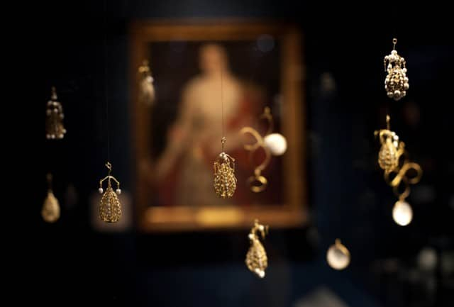 Pearl cage pendants in their display case. © Museum of London