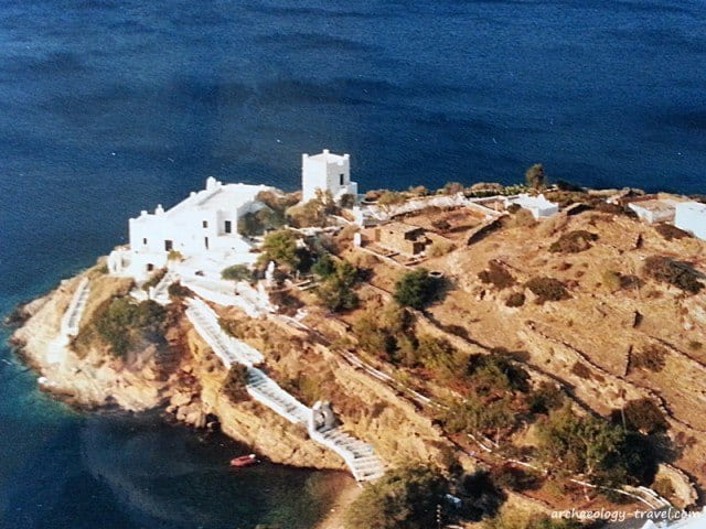 White cubed houses overlook deep blue seas.