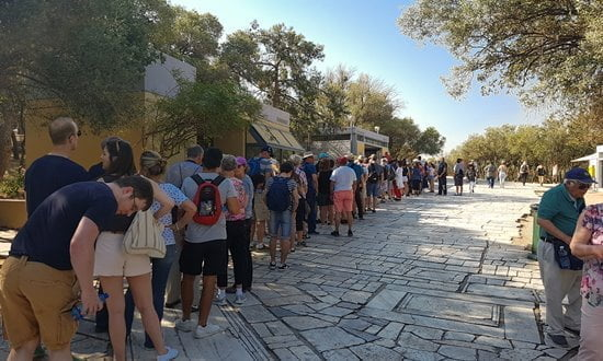 Queues at the Acropolis ticket office first thing in the morning, early summer.