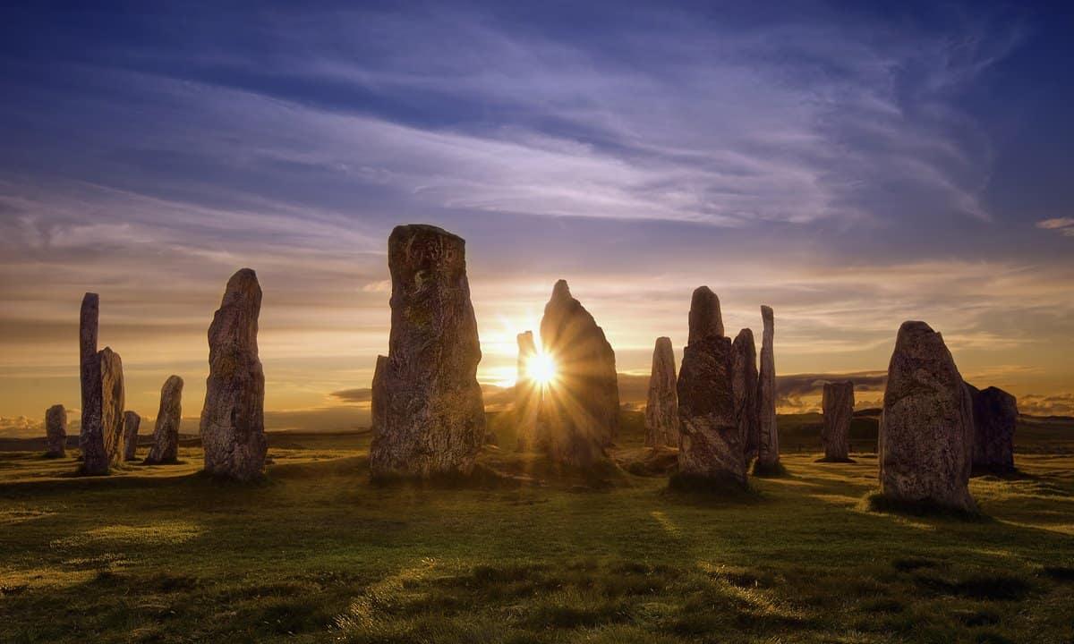 Sunset behind the Callanish stones on the Isle of Lewis, Scotland.