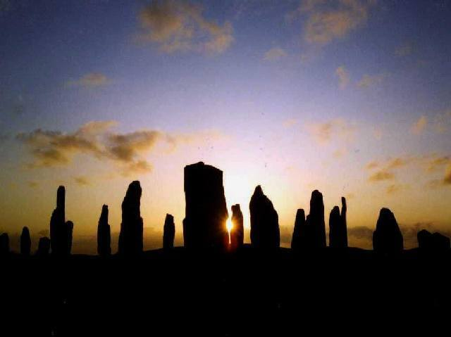 The Callanish Standing Stones at sunset on Midsummer's night.
