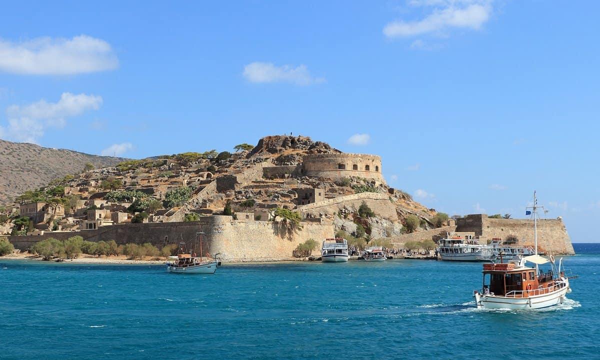 Tourist boats arrive at the Cretan island of Spinalonga.