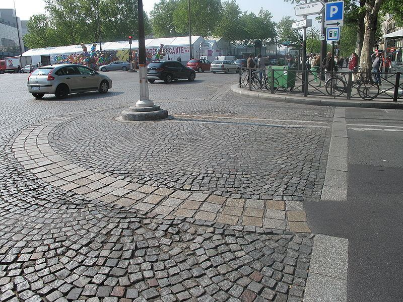 Outline of the Bastille fortress in the cobblestones of the Place de la Bastille.