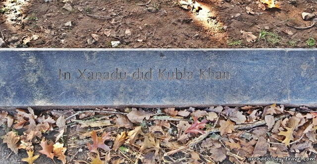 The first line of Coleridge's famous poem, Kubla Khan, etched on a slab in the town park of Ottery St Mary, Devon.
