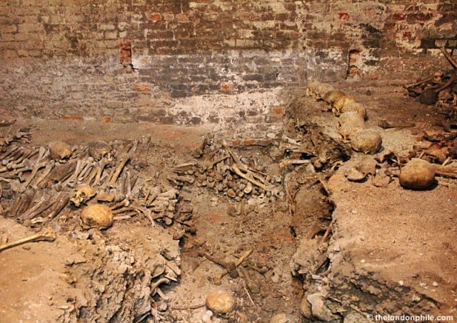 Neatly arranged piles of human bones found in 1953 © thelondonphile.com