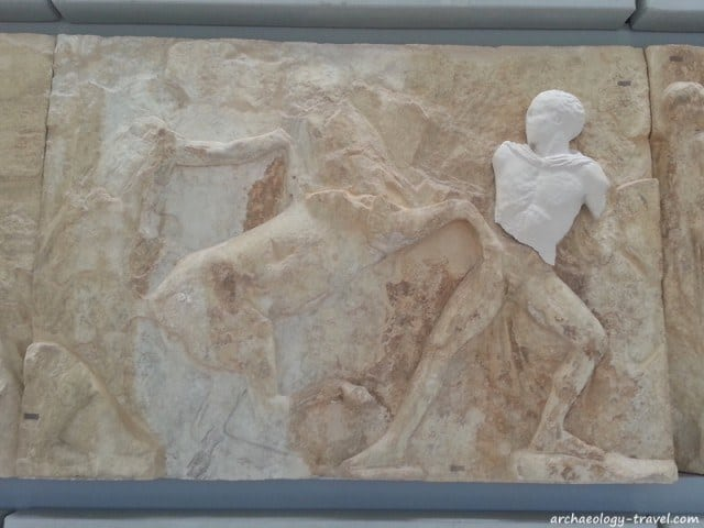 A block from the Parthenon frieze with a replica of the original in the British Museum.