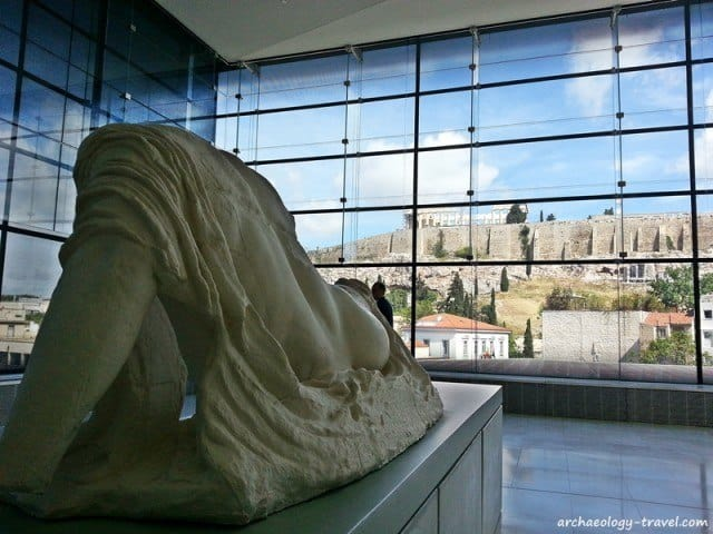 Rear view of the Ilissos sculpture (replica) in view of the acropolis.