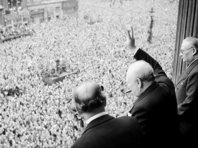 Crowds in Whitehall, London acknowledging Winston Churchill on VE Day in 1945.