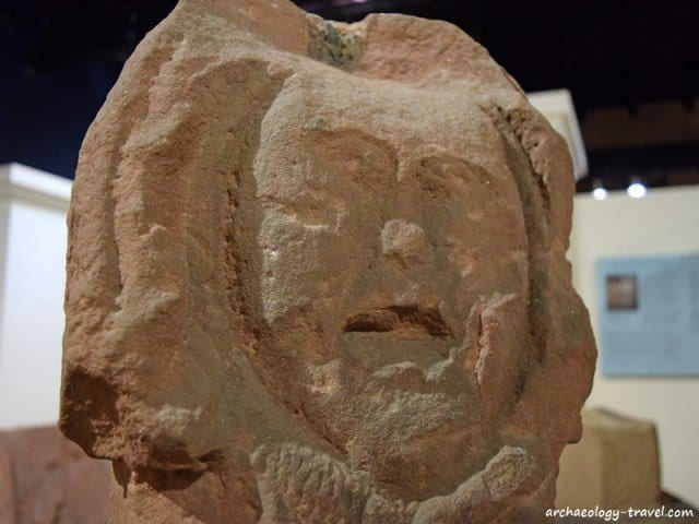 On the reverse side of the serpent is a crude carving of a human head, Senhouse Museum in Maryport.
