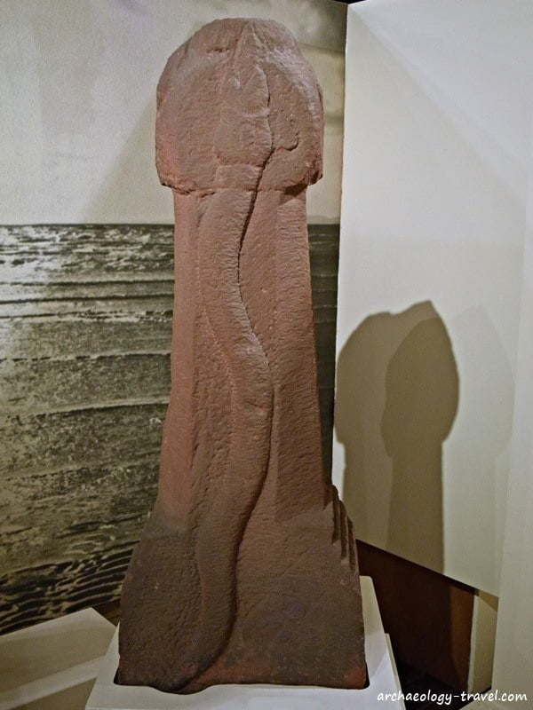 A carved serpent on one side of this pillar, Senhouse Museum in Maryport.