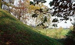 The earthen ramparts of the motte-and-bailey Deddington Castle.