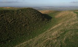The earthen ramparts of the Iron Age hill fort known as Uffington Castle.