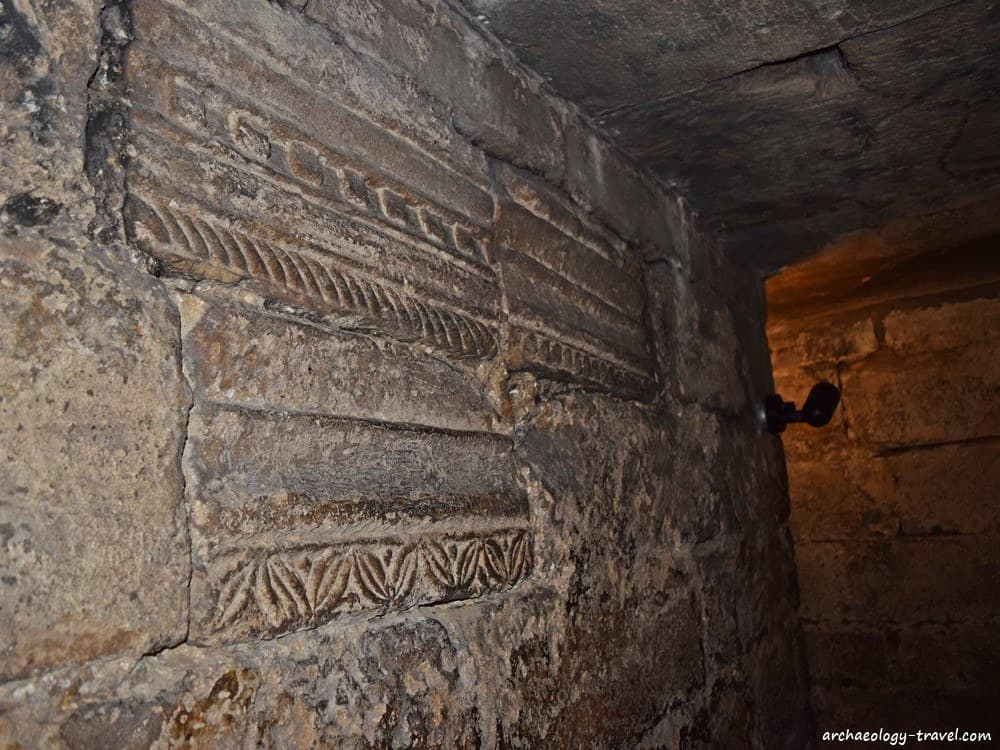 Decorated and dressed stone from Corbridge in the crypt of Hexham Abbey.