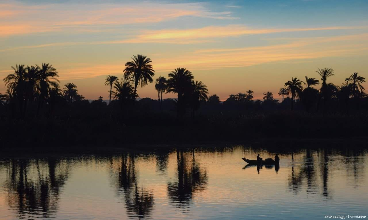 The east bank of the Nile River provides a peaceful silhouette for the rising sun.