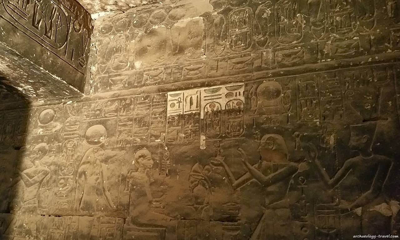 The blackened walls of a chapel in the Temple of Khonsu before restoration.
