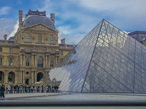 The courtyard of the Louvre Palace with the modern glass pyramid.