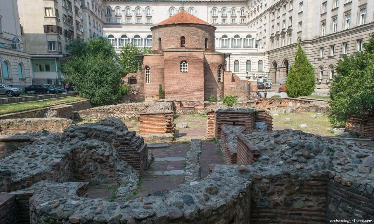 The red-bricked rotunda amidst Roman ruins of Serdica.