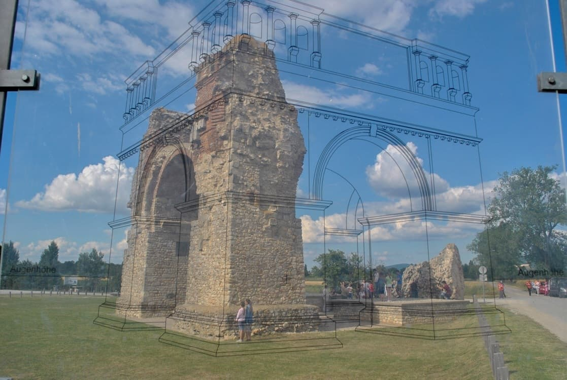 Looking at the triumphal arch through the perspex panel, at Carnuntum in Austria.