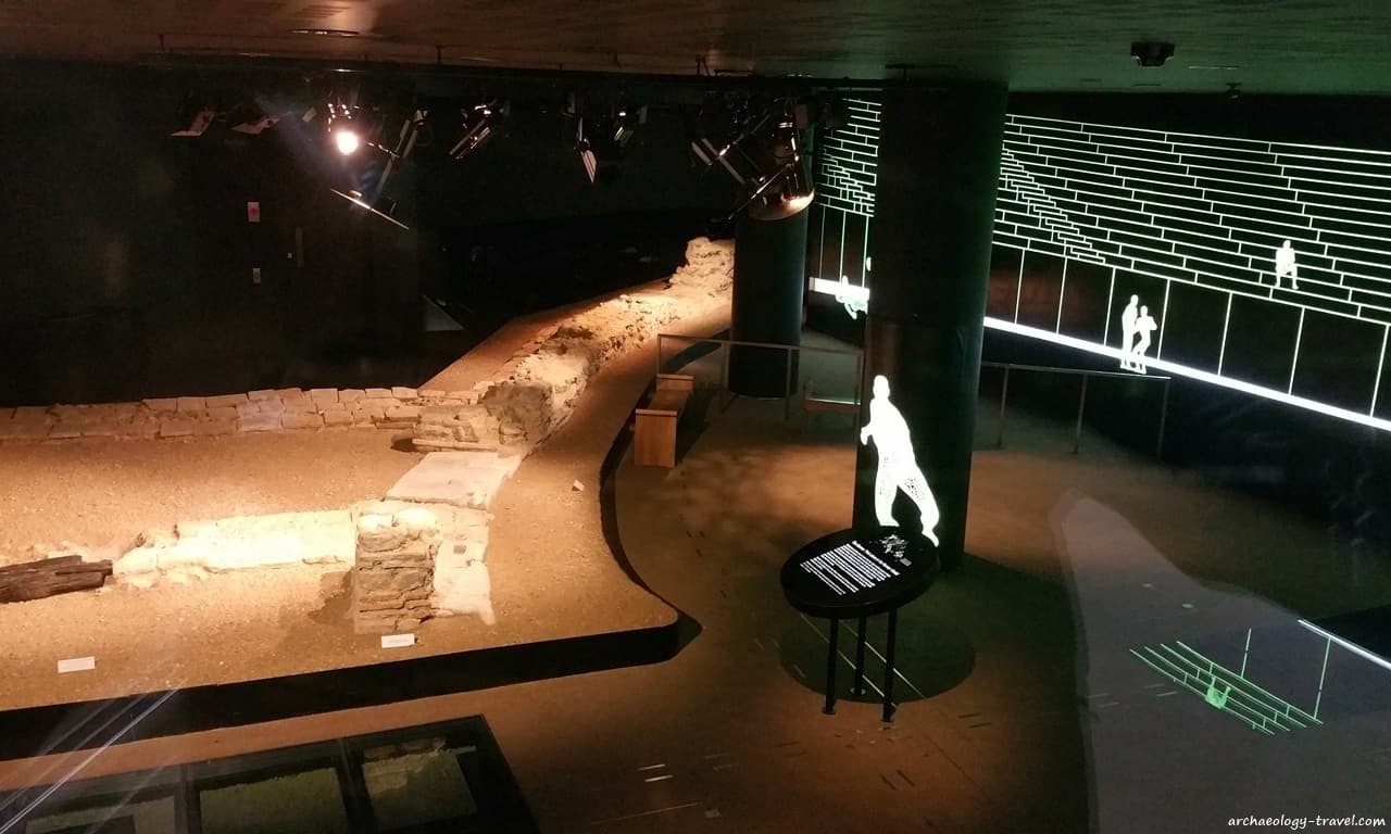 Wall remains and fluorescent lines reconstruct the Roman amphitheatre in London, Guildhall Art Gallery.
