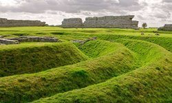 Earthen ramparts surrounding a Roman fort at Richborough, Kent.