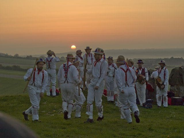 Morris Dancers at the Coldrum Stones at sunrise.