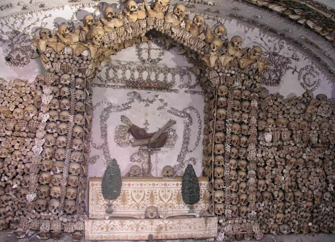 Two severed and mummified arms make up the coat of arms of the Capuchin order in the Capuchin Crypt, Rome. Photo © Dnalor 01/Wikimedia
