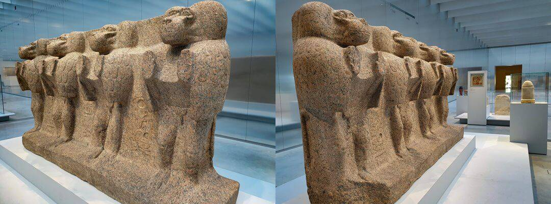 The four baboons on the obelisk pedestal from the side, on display in the Louvre-Lens Museum, France.